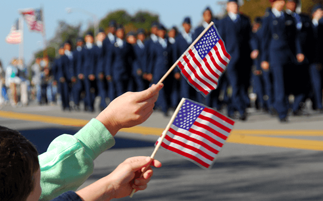 holding flag for veterans parade